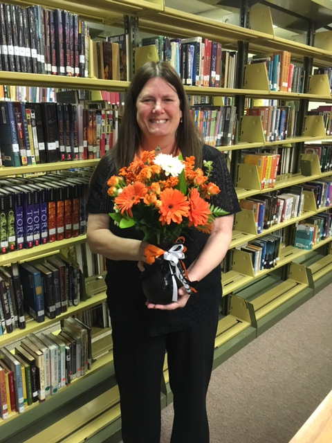 Liz McKee with the bouquet of flowers given to her for winning the 2016 Wirtz Award.